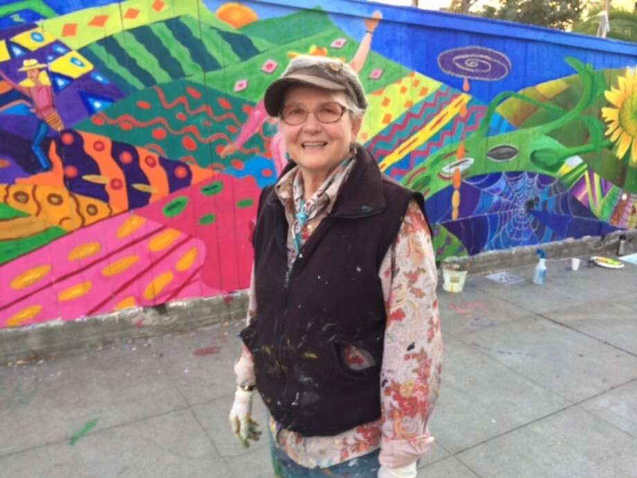 Susan Cervantes at the 200-foot mural at Project Artaud. The Chronicle/Sam Whiting