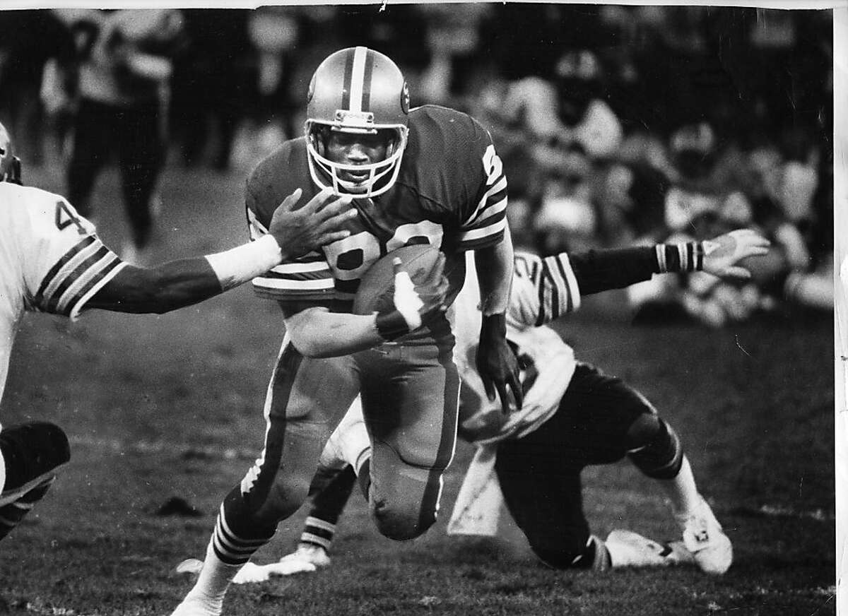 49ers #88 Freddie Solomon drives past the Saints' #44 Dave Waymer for the touchdown in the fourth quarter of the game December 7, 1980.