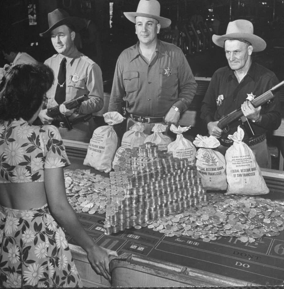 This photo from 1943 shows police guarding $500,000 in silver being used during a WWII war bond rally in a gambling casino. Photo: John Florea, Time & Life Pictures/Getty Image
