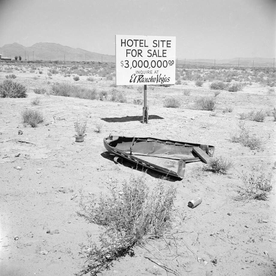 View of an empty lot upon a sign sits which advertises 'Hotel for Sale, $3,000,000--Inquire at El Rancho Vegas,' in 1955. Photo: Loomis Dean