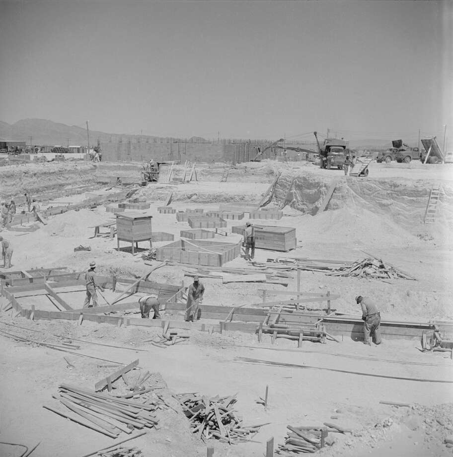 Overview of construction site for the uncompleted Tropicana Hotel in 1955. The casino ended up being more expensive and time consuming for Tropicana owner, Ben Jaffe,  than expected. The other casinos being built along what would eventually become known as The Strip put a strain on the available workforce. Tony Cornero, owner of the Stardust casino down the way, offered to double the salaries of the workers if they would build his casino first. The local workers took the money, forcing Jaffe to ship in more labor from California. The Tropicana eventually opened two years after construction started in 1957. Photo: Loomis Dean