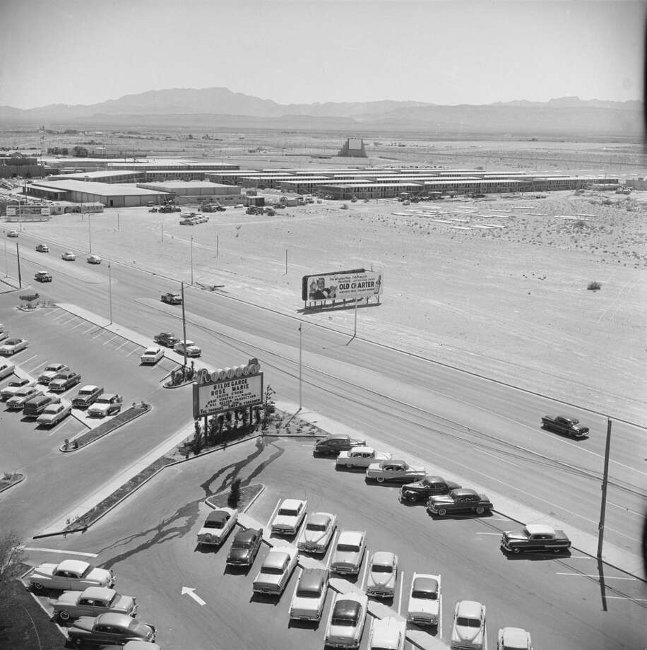Aerial view over the parking lot of the Rivera Hotel and surrounding desert in 1955. Photo: Loomis Dean