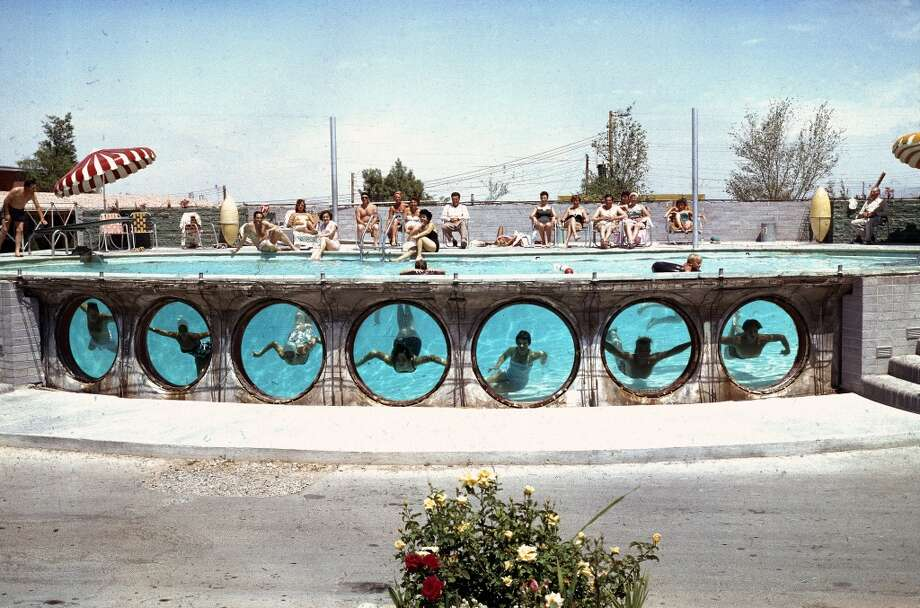 Swimmers look through underwater portholes in a pool at an unidentified Vegas hotel in 1955. Photo: Loomis Dean