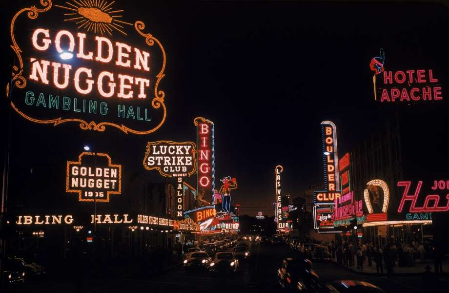 View of the illuminated sign of casinos and hotels along Fremont Street in 1955. Visible are signs for the Golden Nugget, the Lucky Strike Club, the Pioneer Club (the huge neon cowboy named 'Vegas Vic'), the Las Vegas Club, the Boulder Club, and the Hotel Apache, among others. Photo: Loomis Dean, Time & Life Pictures/Getty Image