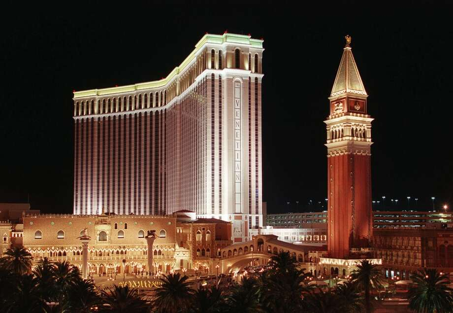 This 1999 view shows the $1.5 billion Venetian Hotel just after opening. The 3,000-room megahotel which opened in April 1999. Even though it was still under completion, the casino contained 14 restaurants and dozens of stores strewn throughout a splashy recreation of Venice, including replicas of the Campanile Tower(R), the Grand Canal, St. Mark Square and the Doge Palace. Photo: JOHN GURZINSKI, AFP/Getty Images