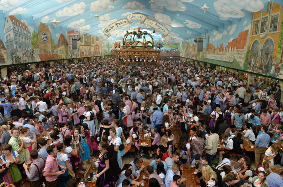 (Floating Holiday) Occurs during the end of September through the beginning of October:  Munich, Germany is home to the largest beer festival in the world called Oktoberfest. If you gave Americans, 21 years of age and older, 3 days off to host our own Oktoberfest, we would give Germans a run for their money! Photo: CHRISTOF STACHE, Getty Images / 2013 AFP