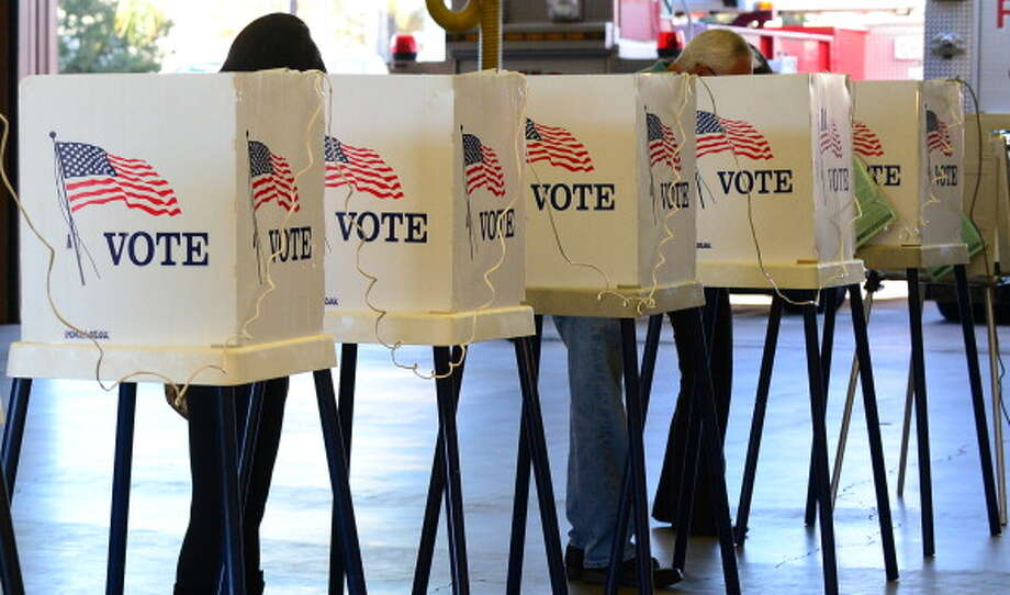 (Floating Holiday) Occurs between Nov. 2 and Nov. 8:  With national and local voter polls down practically year over year, we should help turnout numbers by relinquishing Americans from work on Election Day. Photo: FREDERIC J. BROWN, Getty Images / 2012 AFP