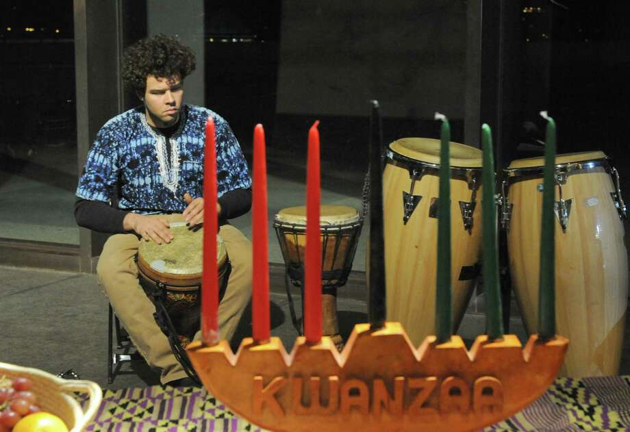 Brinan Weeks of Albany drums during the first day of Kwanzaa celebration at the State Museum on Thursday Dec. 26, 2013 in Colonie, N.Y. The holiday was created in 1966 by Maulana Karenga, professor and chairman of Africana Studies at California State University, Long Beach, to celebrate and promote the African American culture. Albany-area celebrations, sponsored by the Capital Region Kwanzaa Coalition, include: 5 to 9 p.m. Friday, Albany Community Charter School, 42 S. Dove St.; 5 to 8 p.m. Saturday, African American Cultural Center, Madison Avenue and South Pearl Street; 3 to 6 p.m. Sunday, Arbor Hill Community Center, 47 Lark St.; 6 to 8 p.m. Monday, The Coliseum, 153 S. Pearl St.; 5 to 8 p.m. Tuesday, Trinity Alliance, 15 Trinity Place; 2 to 6 p.m. Wednesday, The Book Club, 153 S. Pearl St. For more information about local Kwanzaa observances, call Aaron Carter, 253-1711. (Michael P. Farrell/Times Union) Photo: Michael P. Farrell / 00025134A
