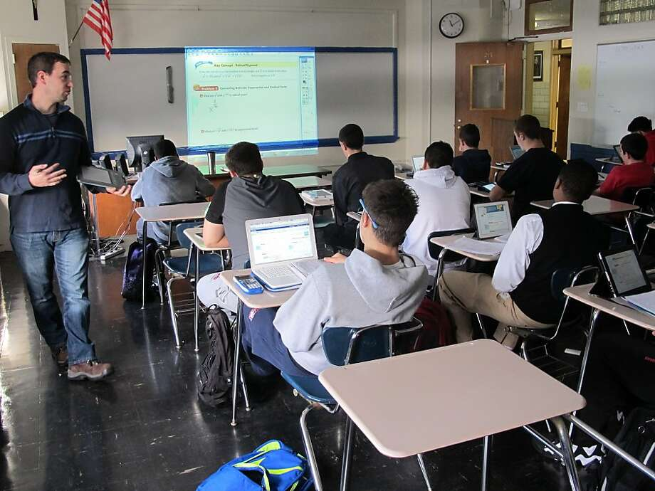 Richard Yapchanyk (left) teaches a math lesson to students at Archbishop Stepinac High School in White Plains, N.Y., with the assistance of an online textbook, joining a national trend. Photo: Jim Fitzgerald, Associated Press