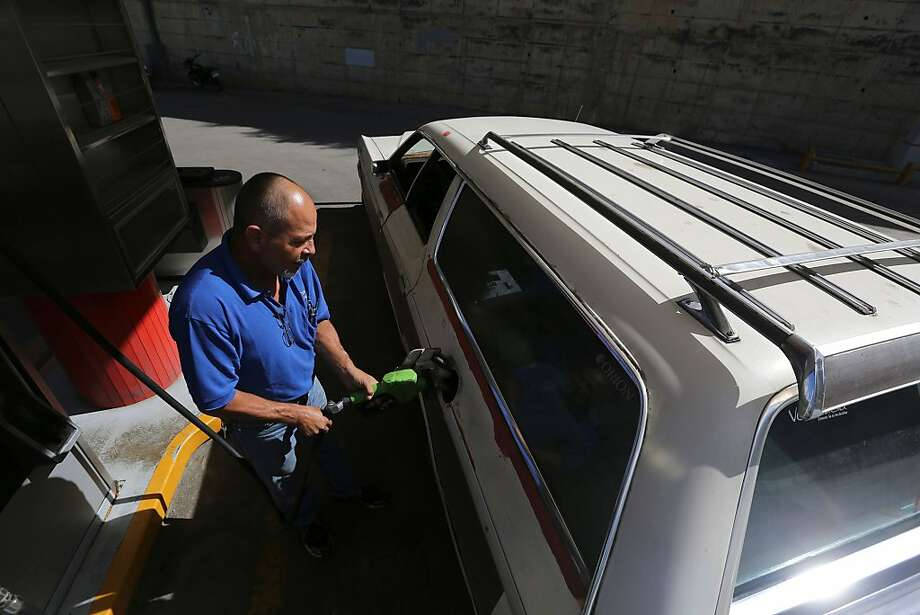 A study shows that families who own fuel-efficient cars tend to buy gas guzzlers as their second vehicle. Photo: Fernando Llano, Associated Press