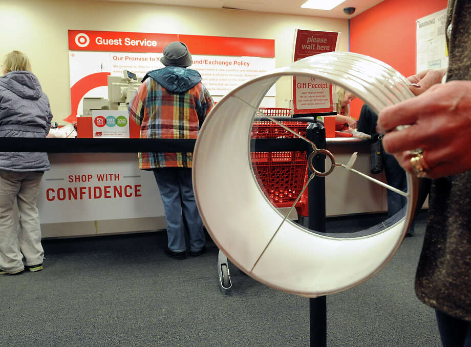 Customers return merchandise at the customer service desk in Target on Thursday, Dec. 26, 2013 in Colonie, N.Y. (Lori Van Buren / Times Union) Photo: Lori Van Buren / 00025162A