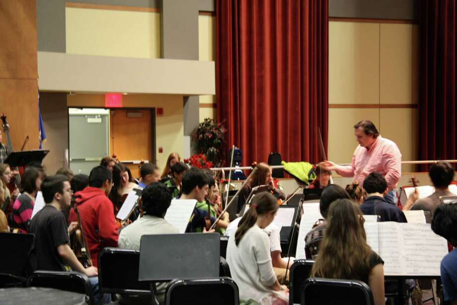 Members of the Greater Bridgeport Youth Orchestras' Principal Orchestra rehearse recently for their Jan. 12 family concert with the Greater Bridgeport Symphony. Christoper Hisey, standing in pink shirt, will conduct both orchestras. Photo: Contributed Photo / Connecticut Post Contributed