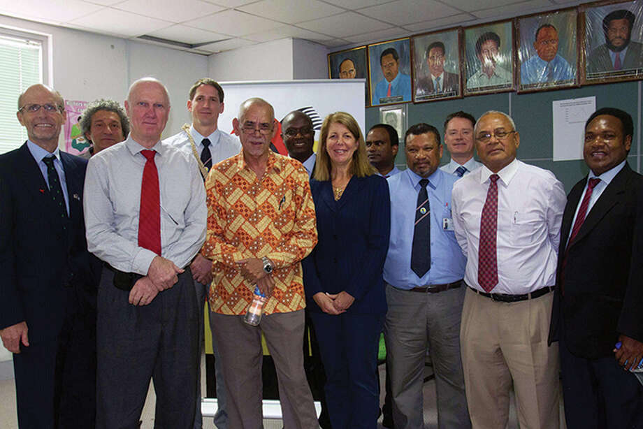 Celebrating a new ExxonMobil funded initiative in which Baylor College of Medicine and Texas Children's Hospital will team with health officials in Papua New Guinea to improve maternal and child health are, from left: Walter North, U.S. Ambassador to Papu Photo: Texas Children's Hospital