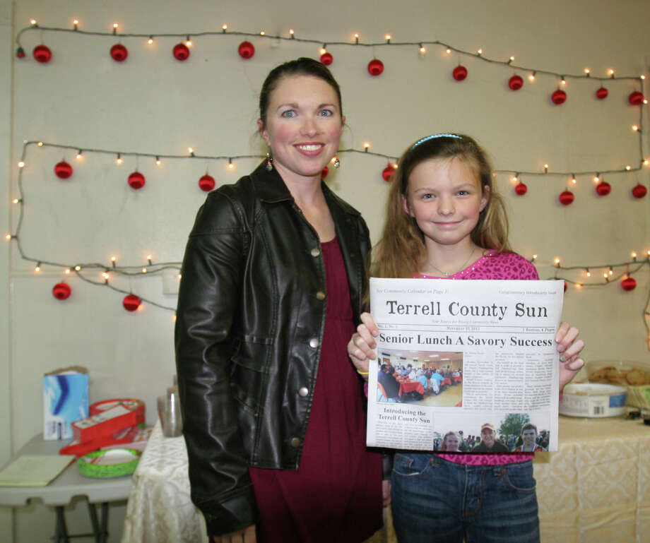 Editor Allison Taylor and her daughter Tristin celebrated the first edition of the Terrell County Sun on Dec. 5 after it was published in late November. Photo: John MacCormack, Staff / © 2013 San Antonio Express-News