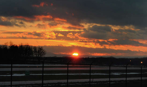 The evening sun sets over the Albany International Airport Thursday, Dec. 26, 2013 in Albany, N.Y. (Lori Van Buren / Times Union) Photo: Lori Van Buren / 00025157A