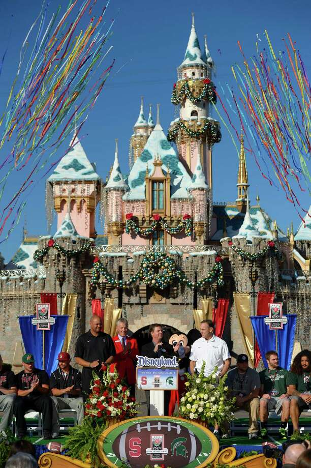Stanford coach David Shaw, standing at left of podium, and Michigan State coach Mark Dantonio, at right of podium, stand along with some of their team members during their visit to Disneyland, Thursday, Dec. 26, 2013, in Anaheim, Calif. Stanford and Michigan State are scheduled to face each other in the Rose Bowl on New Year's Day. (AP Photo/Mark J. Terrill) Photo: Mark J. Terrill / Associated Press / AP
