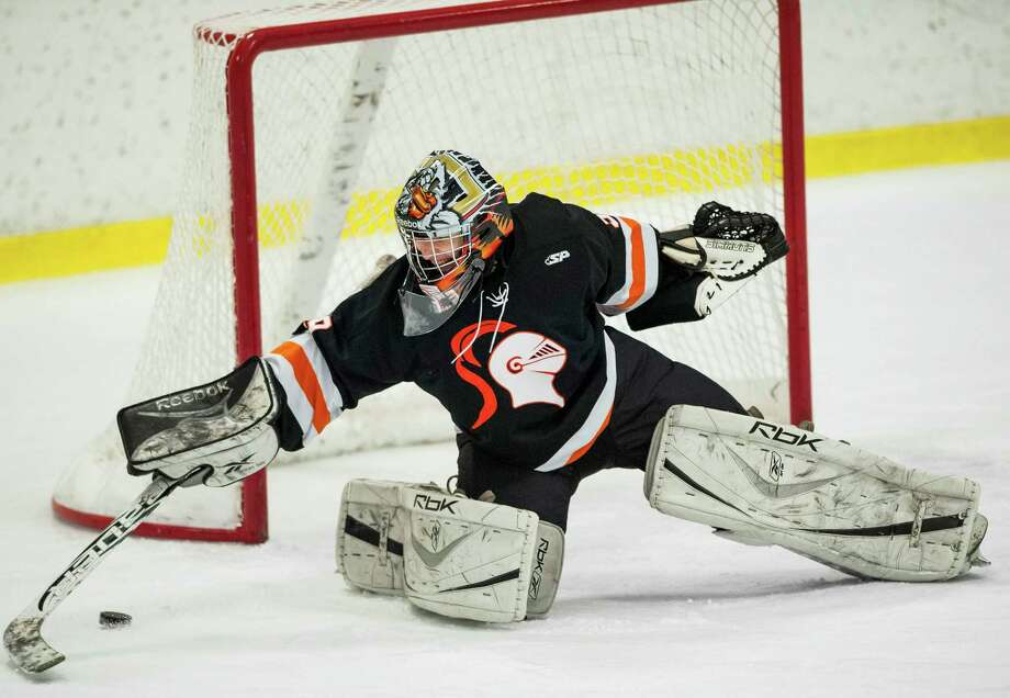 Stamford high school goalie Devin Camlin reaches for a shot wide of the goal during a boys ice hockey game against Westhill high school played at Terry Conners Ice Rink, Stamford, CT on Thursday, December, 26th, 2013. Photo: Mark Conrad / Connecticut Post Freelance