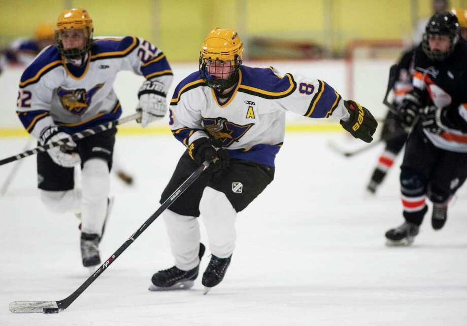 Westhill high school's Ryan Silk moves the puck up ice during a boys ice hockey game against Stamford high school played at Terry Conners Ice Rink, Stamford, CT on Thursday, December, 26th, 2013. Photo: Mark Conrad / Connecticut Post Freelance