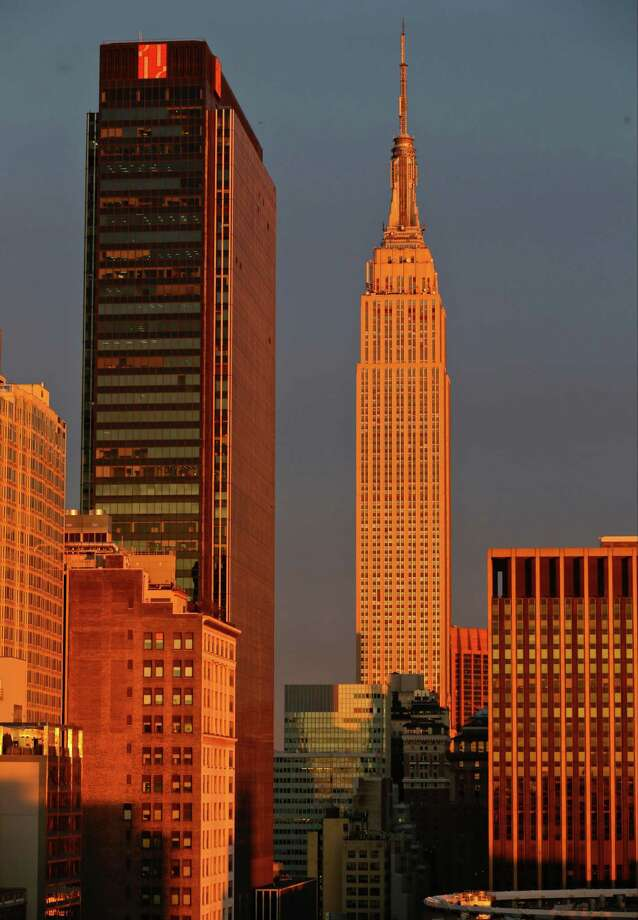 FILE- In this Oct.8, 2013 file photo, sunlight shines on the Empire State Building in New York. A suit filed on Tuesday, Dec. 24, 2013 claims that thousands of stakeholders in the iconic landmark lost more than $400 million in potential profits when the managing owners rebuffed potential buyers in order to sell public shares. By spurning all-cash offers for the tower and instead packaging it with lesser-known office properties into a publicly traded stock, father-and-son real estate magnates Peter and Anthony Malkin put their interests ahead of those of the building's longtime investors, lawyer John Rizio-Hamilton said on Thursday, Dec. 26, 2013. (AP Photo/Frank Franklin II, File) ORG XMIT: NYR102 Photo: Frank Franklin II / AP
