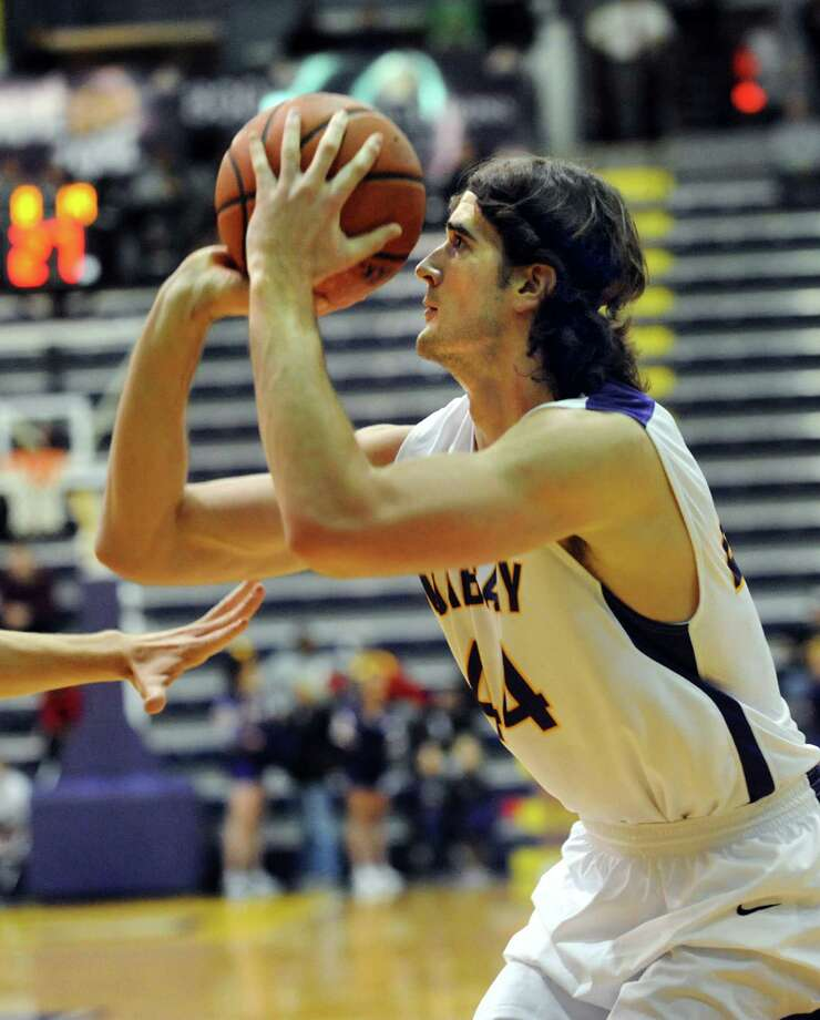UAlbany's John Puk aims for the hoop during their basketball game against Yale on Friday, Dec. 20, 2013, at SEFCU Arena in Albany, N.Y (Cindy Schultz / Times Union) Photo: Cindy Schultz
