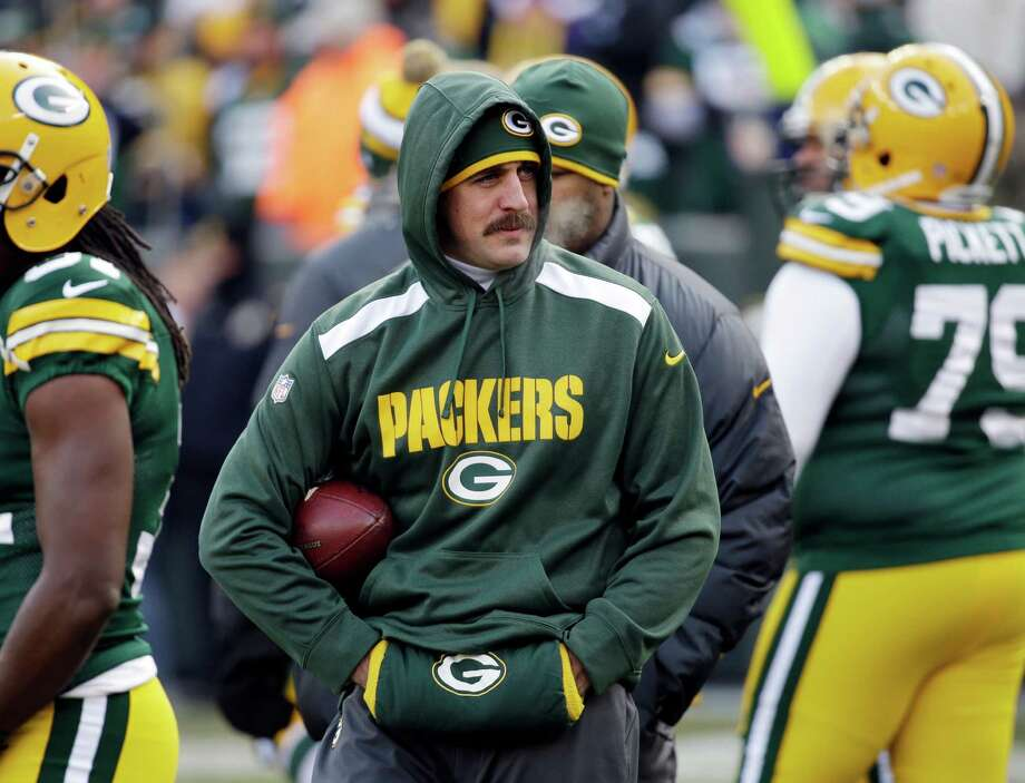 ADVANCE FOR WEEKEND, DEC. 28-29 - In this Nov. 24, 2013, photo, injured Green Bay Packers quarterback Aaron Rodgers stands with a football tucked under his arm before the Packers' NFL game against the Minnesota Vikings in Green Bay, Wis. No injury was more impactful than the Packers losing Rodgers early in their eighth game. They slid from 5-2 to 7-7-1 while using three other starting QBs. (AP Photo/Mike Roemer) ORG XMIT: NY184 Photo: Mike Roemer / FR155603 AP