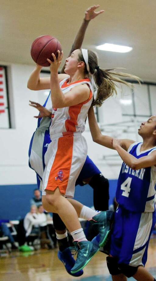 Danbury High School's Rachel Gartner goes up for a shot in a game against Bristol Eastern High School during the News-Times Greater Danbury Holiday Festival girls basketball tournament at the Danbury War Memorial. Thursday, Dec. 26, 2013 Photo: Scott Mullin / The News-Times Freelance