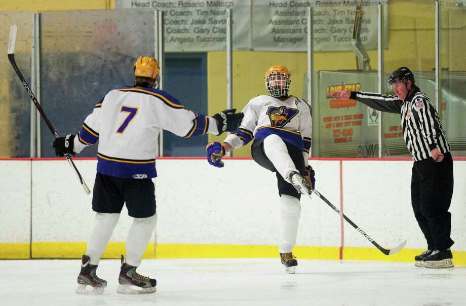 Westhill high school's Neal Smolinski celebrates scoring a goal in the third period during a boys ice hockey game against Stamford high school played at Terry Conners Ice Rink, Stamford, CT on Thursday, December, 26th, 2013. Photo: Mark Conrad / Connecticut Post Freelance