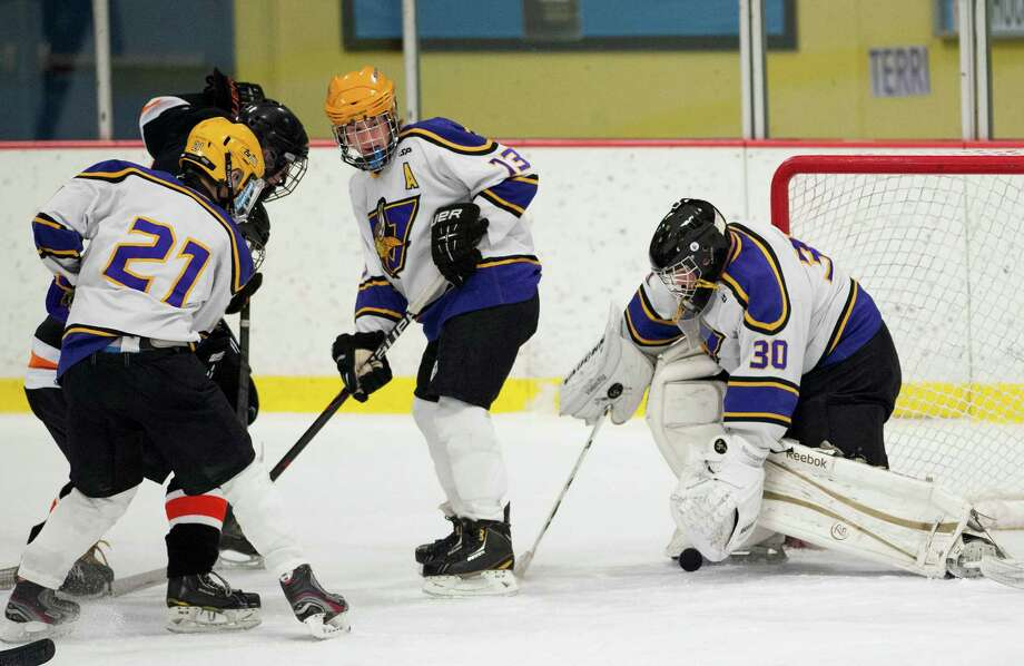 Westhill high school goalie Bradley Smith makes a save during a boys ice hockey game against Stamford high school played at Terry Conners Ice Rink, Stamford, CT on Thursday, December, 26th, 2013. Photo: Mark Conrad / Connecticut Post Freelance