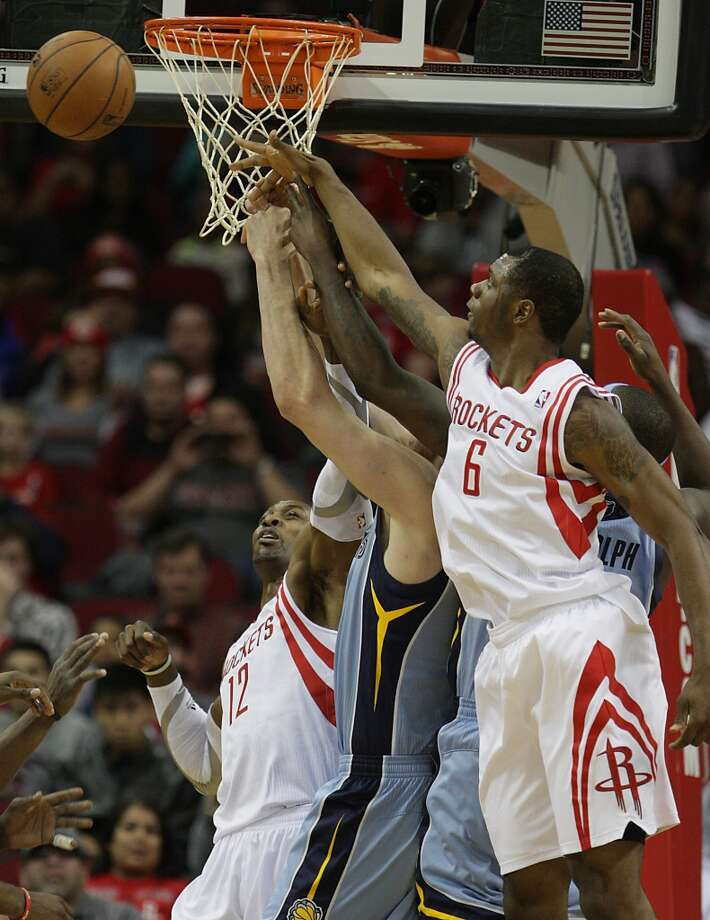Rockets power forward Dwight Howard left, and Terrence Jones right, jump for a rebound. Photo: James Nielsen, Houston Chronicle