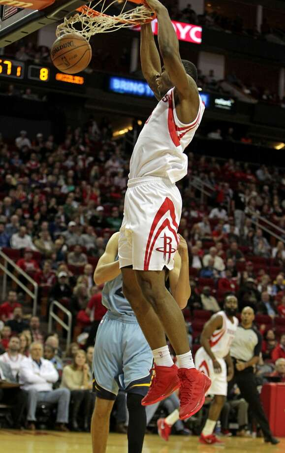 Rockets power forward Terrence Jones slam dunks the ball. Photo: James Nielsen, Houston Chronicle