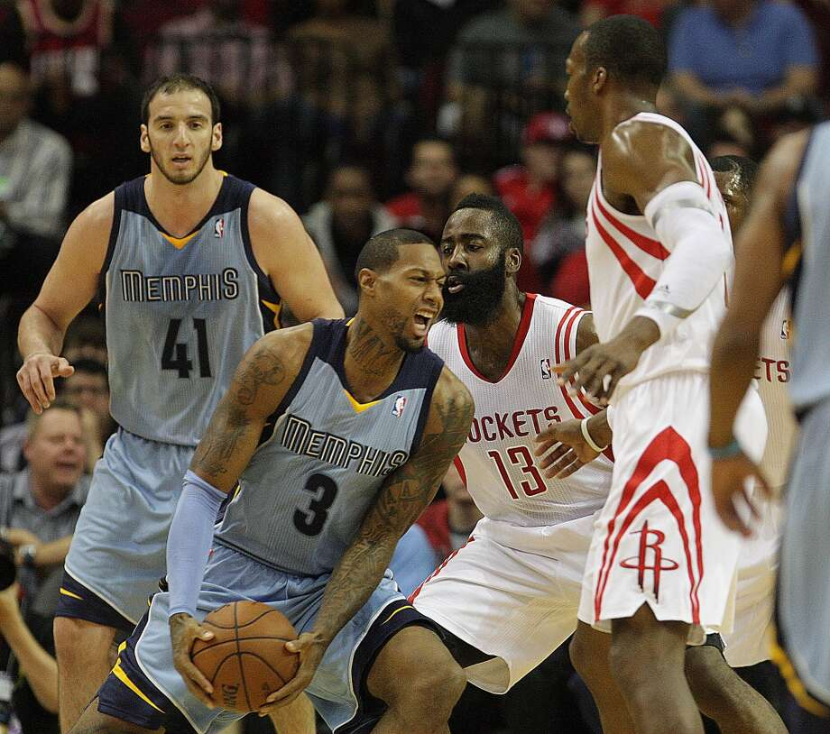 Grizzlies center Kosta Koufos left, power forward James Johnson 2nd from left, Rockets shooting guard James Harden 2nd from right, and Rockets power forward Dwight Howard. Photo: James Nielsen, Houston Chronicle