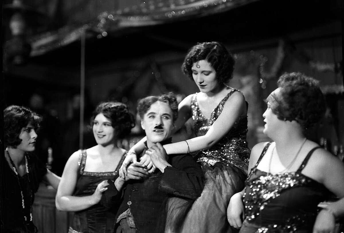 Charles Chaplin and Georgia Hale (on shoulders) in