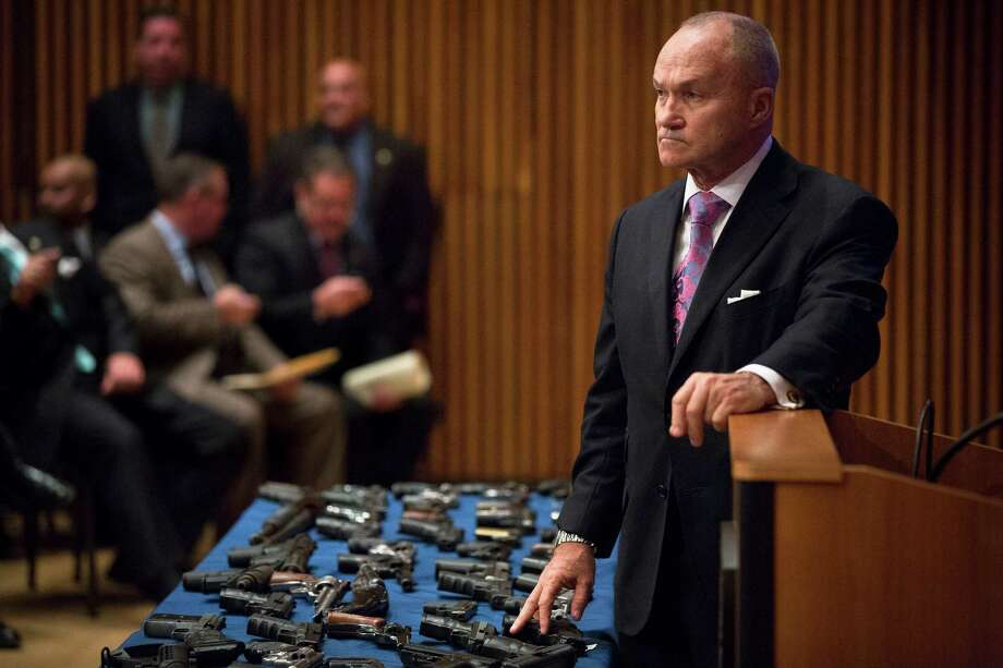 FILE- In this Oct. 12, 2012 file photo, New York City Police Commissioner Raymond Kelly pauses over a table of confiscated firearms before a New York press conference on gun trafficking. With his tenure concluding at the end of the month, New York City's longest serving police commissioner says the high points of his career are the record crime reductions and the fact the city has avoided another terrorist attack. The low points came when police officers died on the job. (AP Photo/John Minchillo, File) ORG XMIT: NYR104 Photo: John Minchillo / FR170537 AP