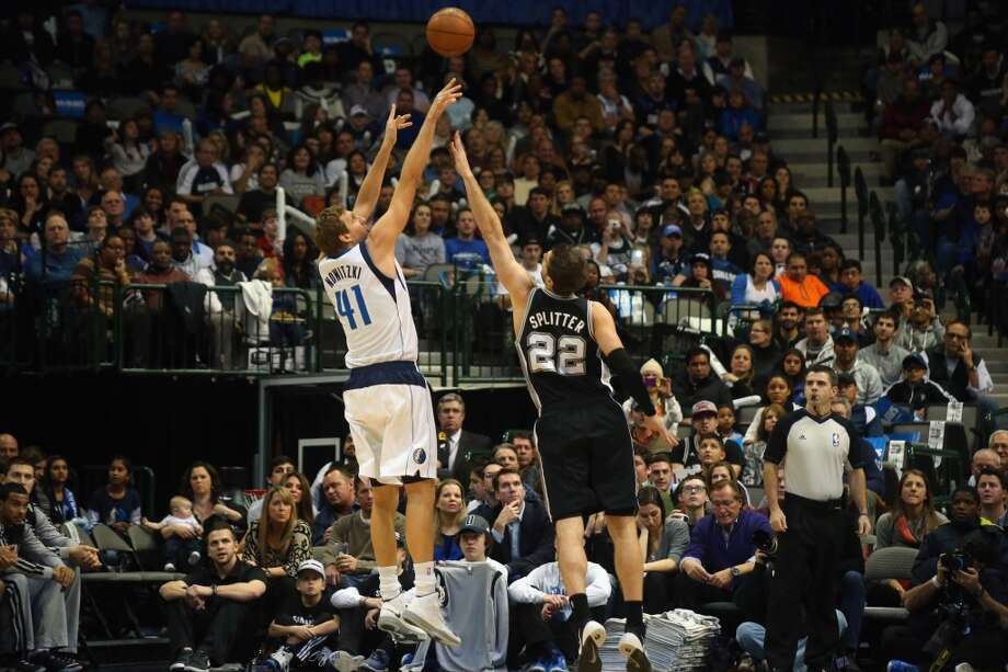 Dirk Nowitzki #41 of the Dallas Mavericks takes a shot against Tiago Splitter #22 of the San Antonio Spurs at American Airlines Center on December 26, 2013 in Dallas. Photo: Ronald Martinez, Getty Images