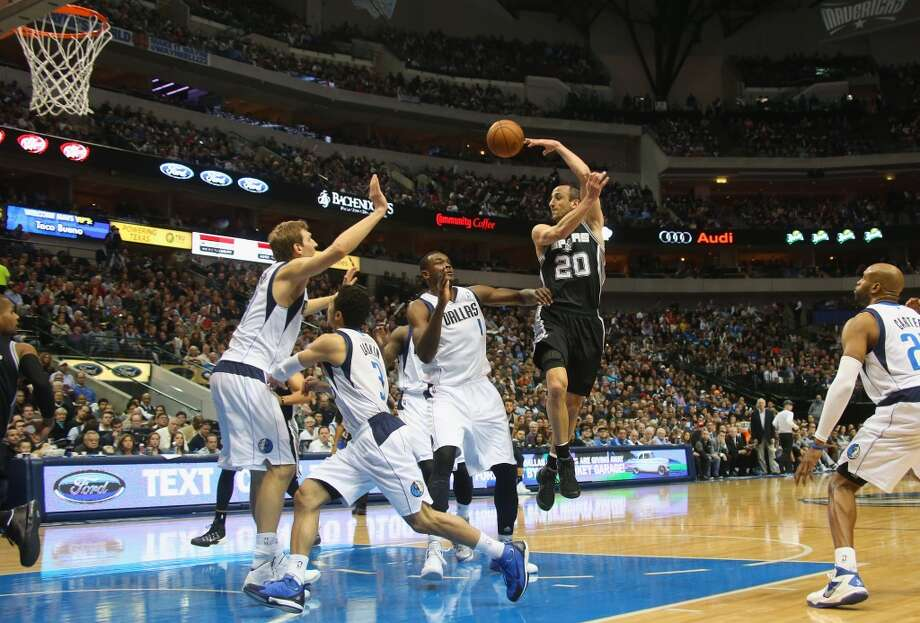 Manu Ginobili #20 of the San Antonio Spurs passes the ball against the Dallas Mavericks at American Airlines Center on December 26, 2013 in Dallas. Photo: Ronald Martinez, Getty Images