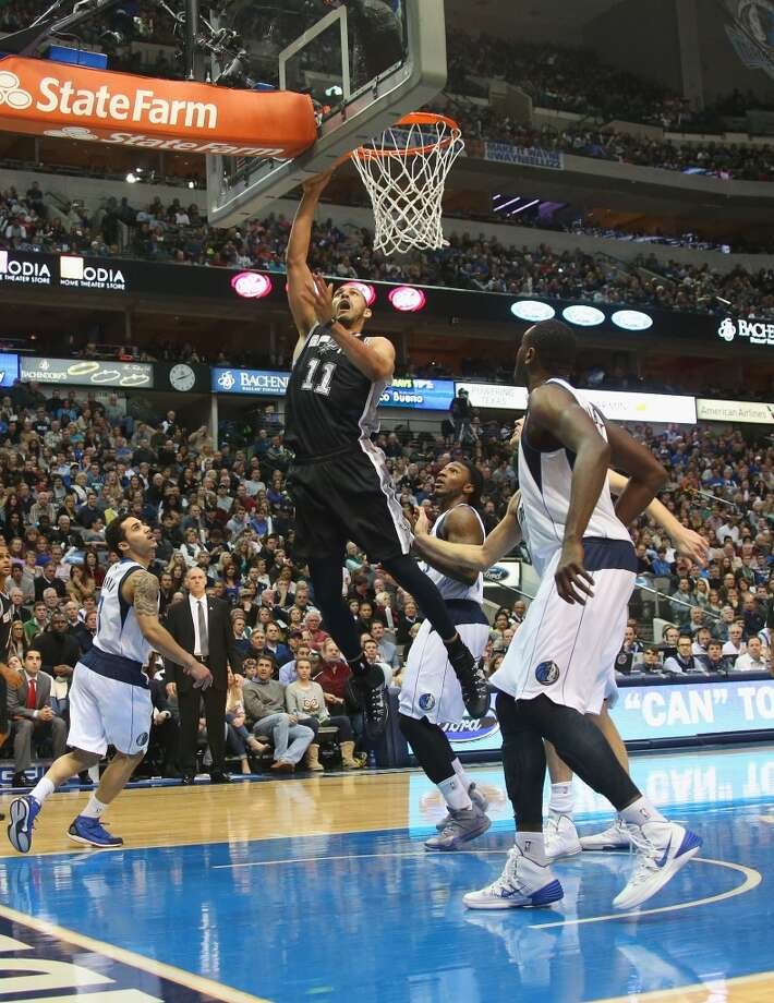 Jeff Ayres #11 of the San Antonio Spurs takes a shot against the Dallas Mavericks at American Airlines Center on December 26, 2013 in Dallas. Photo: Ronald Martinez, Getty Images