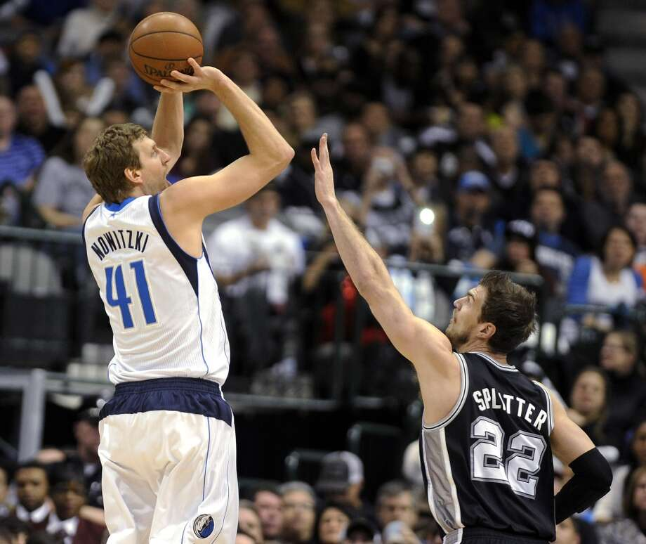 Dallas Mavericks forward Dirk Nowitzki (41) shoots over San Antonio Spurs center Tiago Splitter (22) during the first half of an NBA basketball game, Thursday, Dec. 26, 2013, in Dallas. Photo: Matt Strasen, Associated Press