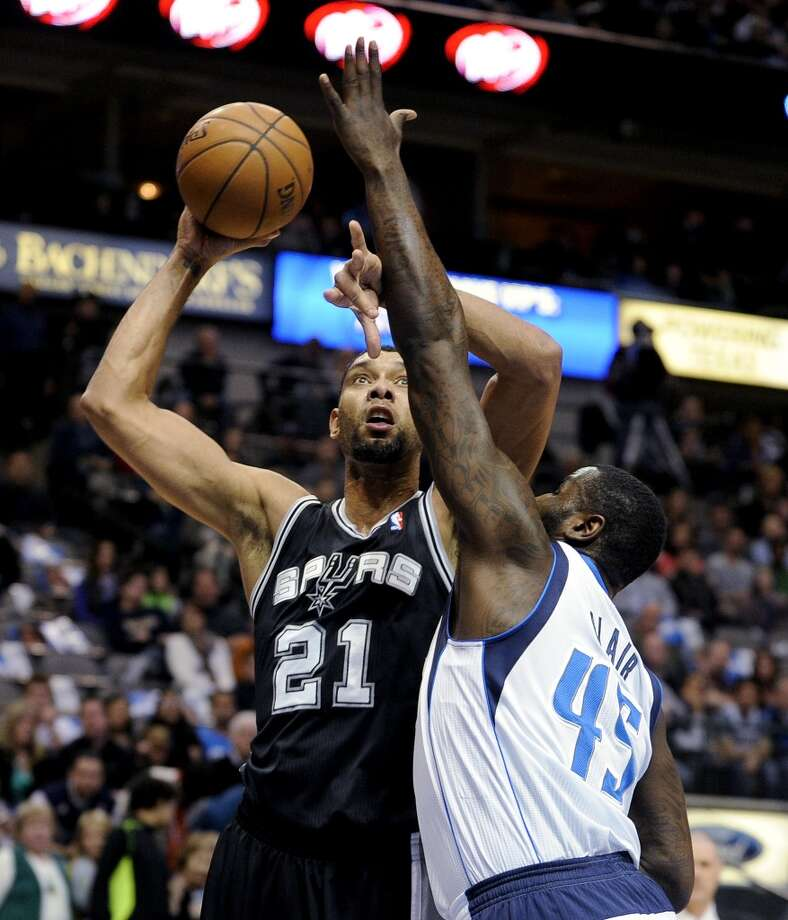 San Antonio Spurs forward Tim Duncan (21) shoots over Dallas Mavericks center DeJuan Blair (45) during the first half of an NBA basketball game, Thursday, Dec. 26, 2013, in Dallas. Photo: Matt Strasen, Associated Press