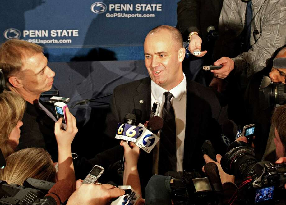 Penn State's new football coach Bill O'Brien is surrounded by the media after he was introduced during an NCAA college football news conference, Saturday, Jan. 7, 2012, in State College, Pa. O'Brien, who is currently the offensive coordinator for the New England Patriots, replaces Hall of Famer Joe Paterno, fired Nov. 9 in the aftermath of child sex abuse charges against retired assistant coach Jerry Sandusky. (AP Photo/Andy Colwell) Photo: AP / FRE170637 AP