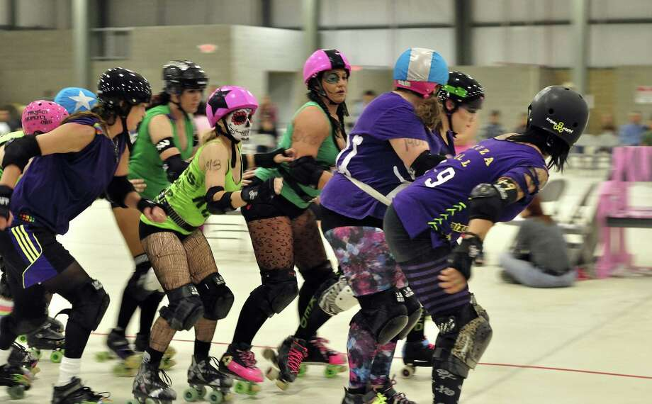 Kara Grant (star on helmet) of Kerr County Roller Derby tries to penetrate a visiting squad's blockers in November in Kerrville. Photo: David Jackson / Courtesy Photos