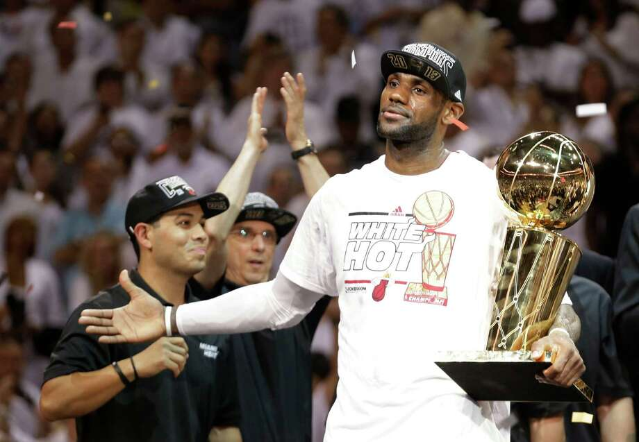 The year has been filled with awards for LeBron James, who squeezed in one more - the AP Male Athlete of the Year - five days before the calendar flips to 2014. Photo: Lynne Sladky, STF / AP