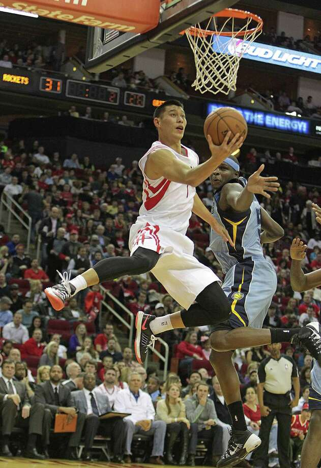 Jeremy Lin is just too quick for the Grizzlies' Zach Randolph, who can do little more than wave as the Rockets point guard zips by and scores on a reverse layup in the second quarter Thursday night. Photo: James Nielsen, Staff / © 2013  Houston Chronicle