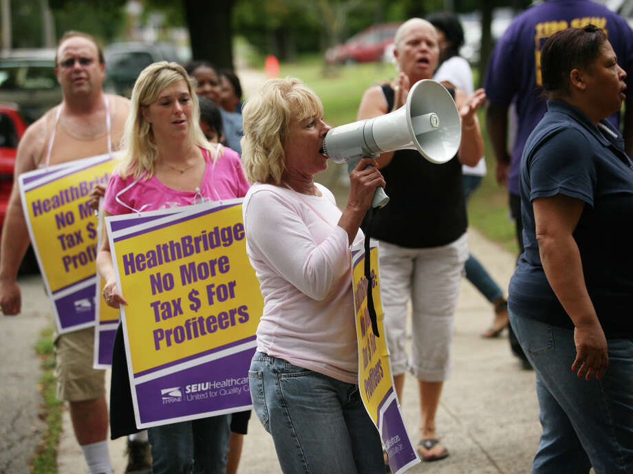 Cindy Bain of Milford leads healthcare union picketers in sing-along chants of her own design in at West River Health Care at 245 Orange Avenue in Milford on Thursday, September 6, 2012. The workers have been on strike for months, after refusing what they see as an unfair contract offer by the nursing home's owner, HealthBridge. Photo: Brian A. Pounds / Connecticut Post