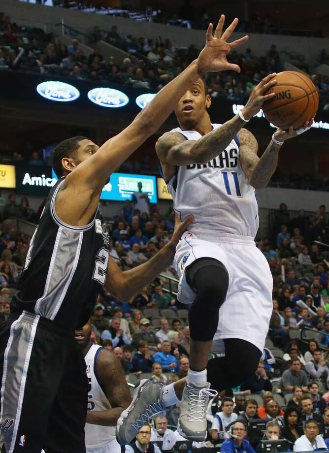 Monta Ellis #11 of the Dallas Mavericks takes a shot against Tim Duncan #21 of the San Antonio Spurs at American Airlines Center on December 26, 2013 in Dallas. Photo: Ronald Martinez, Getty Images