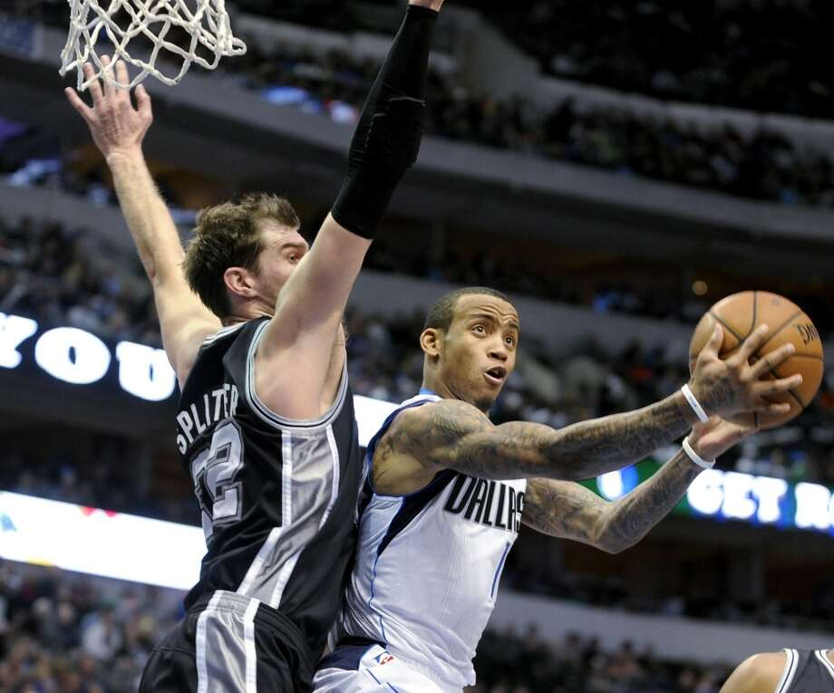 Dallas Mavericks guard Monta Ellis (11) drives to the basket on San Antonio Spurs center Tiago Splitter (22) in the second half during an NBA basketball game, Thursday, Dec. 26, 2013, in Dallas. The San Antonio Spurs won 116-107. Photo: Matt Strasen, Associated Press