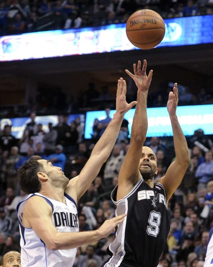San Antonio Spurs guard Tony Parker (9) shoots over Dallas Mavericks guard Jose Calderon (8) during the second half of an NBA basketball game, Thursday, Dec. 26, 2013, in Dallas. The Spurs won 116-107. Photo: Matt Strasen, Associated Press