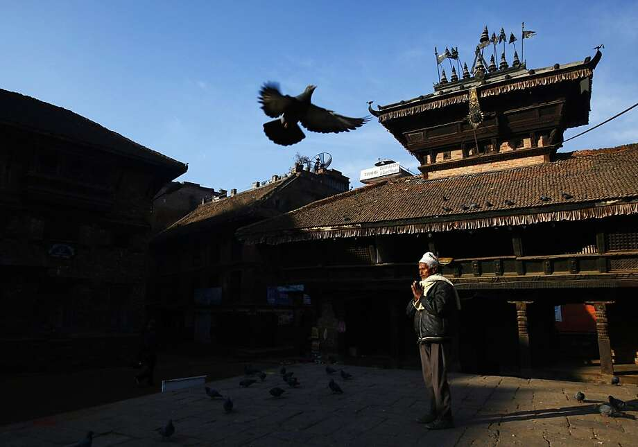 An elderly man offers prayers in Bhaktapur, Nepal, Thursday, Dec. 26, 2013. Bhaktapur, also known as the city of devotees, is an ancient city dominated by the Newar community, and popular for its traditional architectural buildings, temples and unique festivals. (AP Photo/Niranjan Shrestha) Photo: Niranjan Shrestha, Associated Press