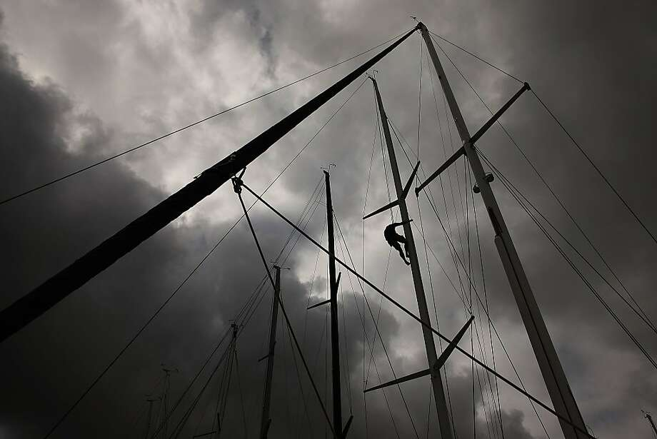 SYDNEY, AUSTRALIA - DECEMBER 26:  A crew member makes final adjustments to a yachts rigging prior to the 2013 Sydney to Hobart yacht race on December 26, 2013 in Sydney, Australia.  (Photo by Brendon Thorne/Getty Images) *** BESTPIX *** Photo: Brendon Thorne, Getty Images