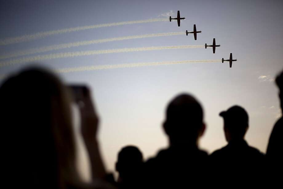 Israeli Air Force acrobatic team T-6 Texan II planes perform during a graduation ceremony for new pilots in the Hatzerim air force base near the city of Beersheba, southern Israel, Thursday, Dec. 26, 2013. (AP Photo/Ariel Schalit) Photo: Ariel Schalit, Associated Press
