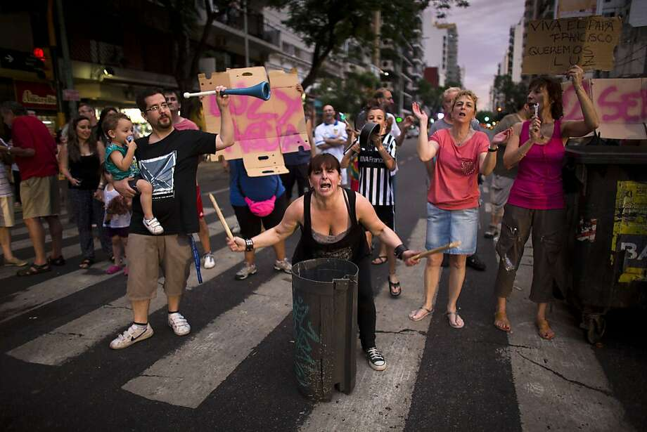 People that have been without electricity for almost two weeks protest by blocking an avenue in Buenos Aires, Argentina, Thursday, Dec. 26, 2013. Power outages continue in Argentina's capital, where electricity usage is setting new records amid 100-degree (37.8 Celsius) temperatures in the Southern Hemisphere summer.  (AP Photo/Victor R. Caivano) Photo: Victor R. Caivano, Associated Press